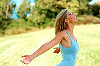 Side view of girl with arms outstretched enjoying at the park