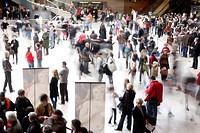 Crowd in Louvre museum entrance hall Paris, France