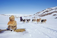 Dogsled team crossing Meta Incognita Peninsula, Baffin Island, Nunavut, Canada.