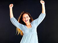 Happy woman with arms overhead