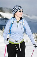 A woman cross country skiing in Strathcona Provincial Park, Vancouver Island, British Columbia, Canada.
