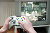 ADOLESCENT PLAYING VIDEO GAME