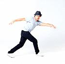 Portrait of a young male hip hop dancer posing on grey background _ Copyspace