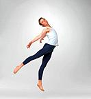Full length of a male ballet dancer performing against white background _ copyspace