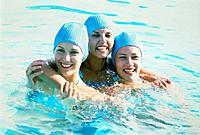 Three young women in the water