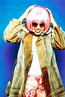 Young woman with pink hair and sunglasses
