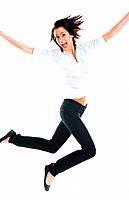Cute young energetic woman jumping in air against white