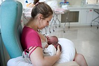 Photo essay at the maternity of the Diaconesses hospital in the 12th district of Paris, France. Simultaneous breastfeeding of twins thanks to the rugb...