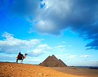 Pyramid and camel rider in Egypt