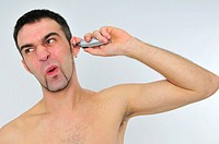 man shaving the nose hairs
