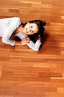 Portrait of a cute young woman relaxing on the floor