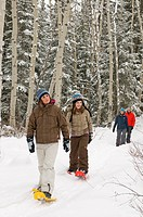 A young family enjoys a day out snowshoeing in Jasper National park, near Jasper, Alberta Canada