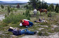 Trail riders take a siesta in the Itcha Mountains in British Columbia Canada