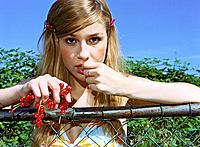 Blond Woman Eating Redcurrants