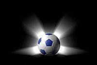 Glowing soccer ball over black background with alpha channel