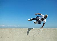 Young Man Jumping Wall