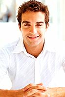 Portrait of casual young guy smiling and looking at you