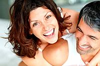 Closeup of playful middle aged couple having fun in bedroom _ Indoor