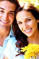Closeup portrait of charming young love couple enjoying themselves outdoors
