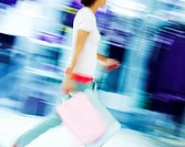 Blur motion image of a woman shopping