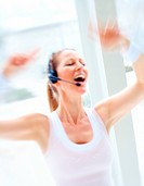 Female gym instructor with headset in motion
