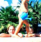 Two Girls and Toddler at Swimming Pool