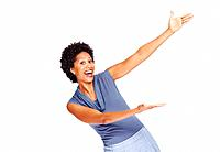 Portrait of an excited young woman pointing over white background with copy space