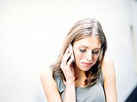 Crying Young Woman Talking on Cell Phone