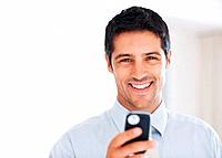 Closeup of handsome young business man reading text message and smiling _ copyspace