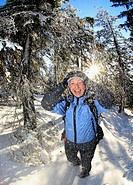 young woman in a winter forest, Austria, Tyrol, Kufstein