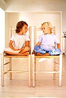 Girl and boy sitting on chairs