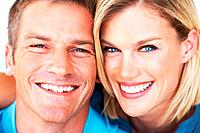 Closeup portrait of happy middle aged couple smiling together