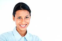Portrait of charming female executive smiling over white background