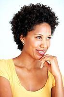 Closeup of attractive African American woman thinking over white background