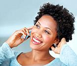 Gorgeous African American woman smiling while talking on cellphone