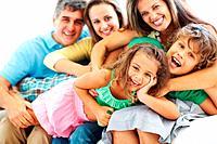 Portrait of happy parents with children enjoying