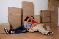 young couple moving house and taking a break
