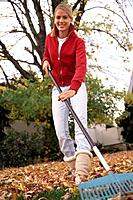 Teenage Girl Raking Foliage