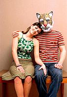 Woman and man wearing a mask