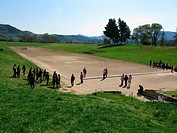 tourists in the ancient stadium of Olympia, Greece, Peloponnes, Olympia