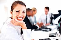 Portrait of a happy young businesswoman smiling and her colleagues working behind at office