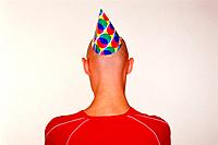 Young man wearing party hat