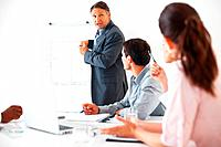 Mature executive giving presentation to colleagues using whiteboard