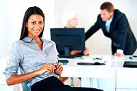 Business people working at office with businesswoman sitting in front