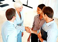 Successful business team shaking hands at office _ Business agreement