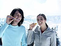 Young Couple Brushing Teeth in Mountain Landscape