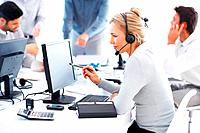 Female support phone operator using headset and computer