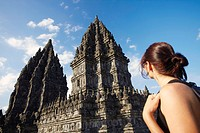 Woman looking at temple, Prambanan, Java, Indonesia
