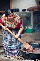 Guatemala, Mayan woman with pot of beans