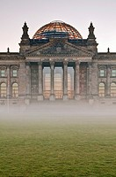 Sunrise behind the Reichstag German Parliament with morning fog, Government District, Berlin, Germany, frontal shot
